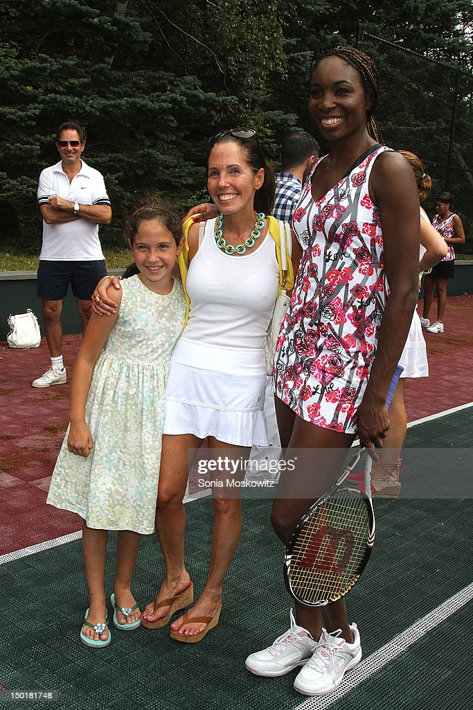 Guest, Elizabeth Harrison and Venus Williams attend the EleVen by Venus Williams party on August 11, 2012 in Southampton, New York.