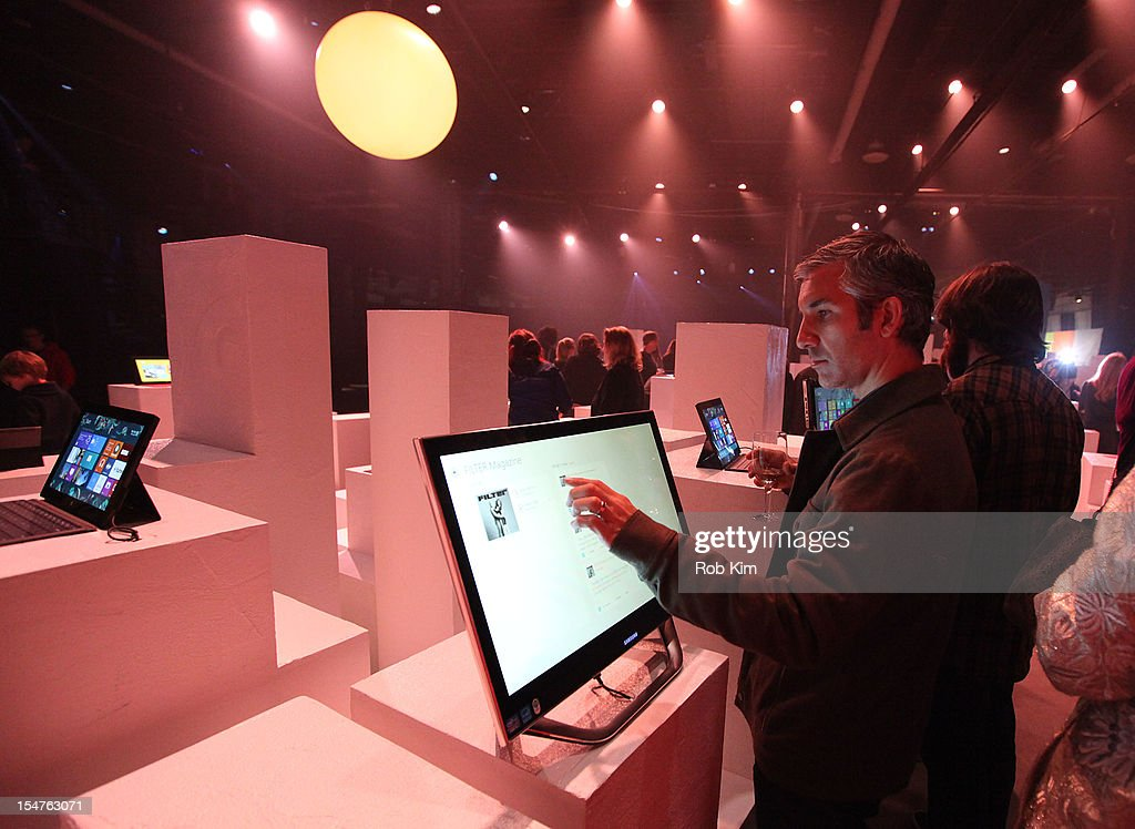 A guest enjoys the interactive experience at the Microsoft Windows 8 launch at Pier 57 on October 25 2012 in New York City
