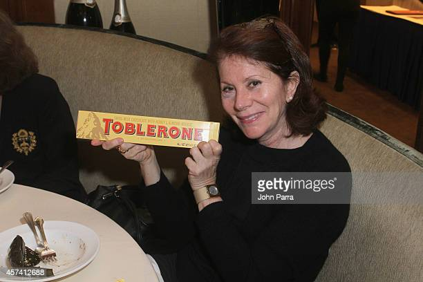 Guest enjoys Toblerone at Evolution Of Mexican Cuisine hosted by Enrique Olvera as a part of the Bank of America Dinner Series during the Food...