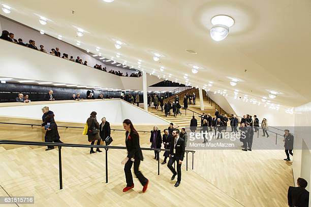 Guest enter the foyer as they attend the opening concert of the Elbphilharmonie concert hall on January 11 2017 in Hamburg Germany Tonights opening...