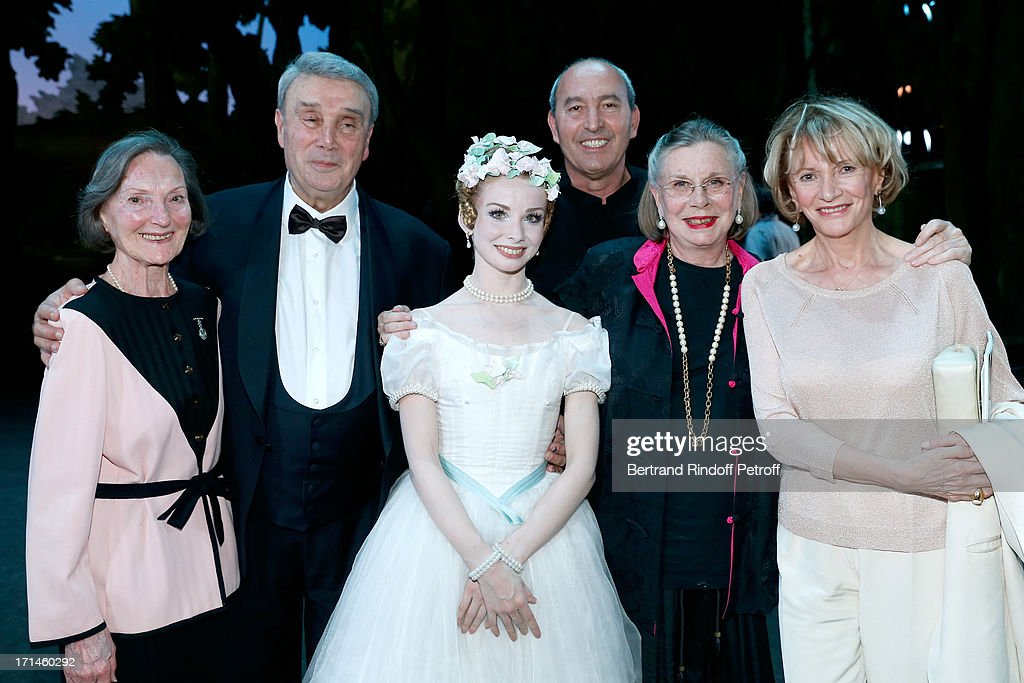 Guest (L), Former Star Dancer of Opera de Paris Ghislaine Thesmar (2nd R) with her husband Choreographer Pierre Lacotte, honored in this gala (2nd L), Main Dancer of Bolchoi Evgenia Obrastzova (3rd L) and Eve Ruggieri (R) and her husband Rachid Kimoune (3rd R) on stage at Gala of AROP at Opera Garnier with representation of 'La Sylphide' on June 24, 2013 in Paris, France.
