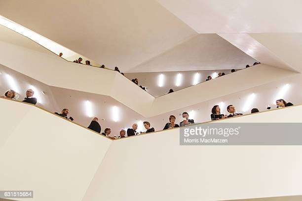 Guest gather in the foyer as they attend the opening concert of the Elbphilharmonie concert hall on January 11 2017 in Hamburg Germany Tonights...