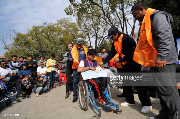 Guest giving 1st Prize along with cash prize of NRs 25000 to PREM BK on male catagory after competing in the 1st Bodhisattvas In Action Wheelchair...