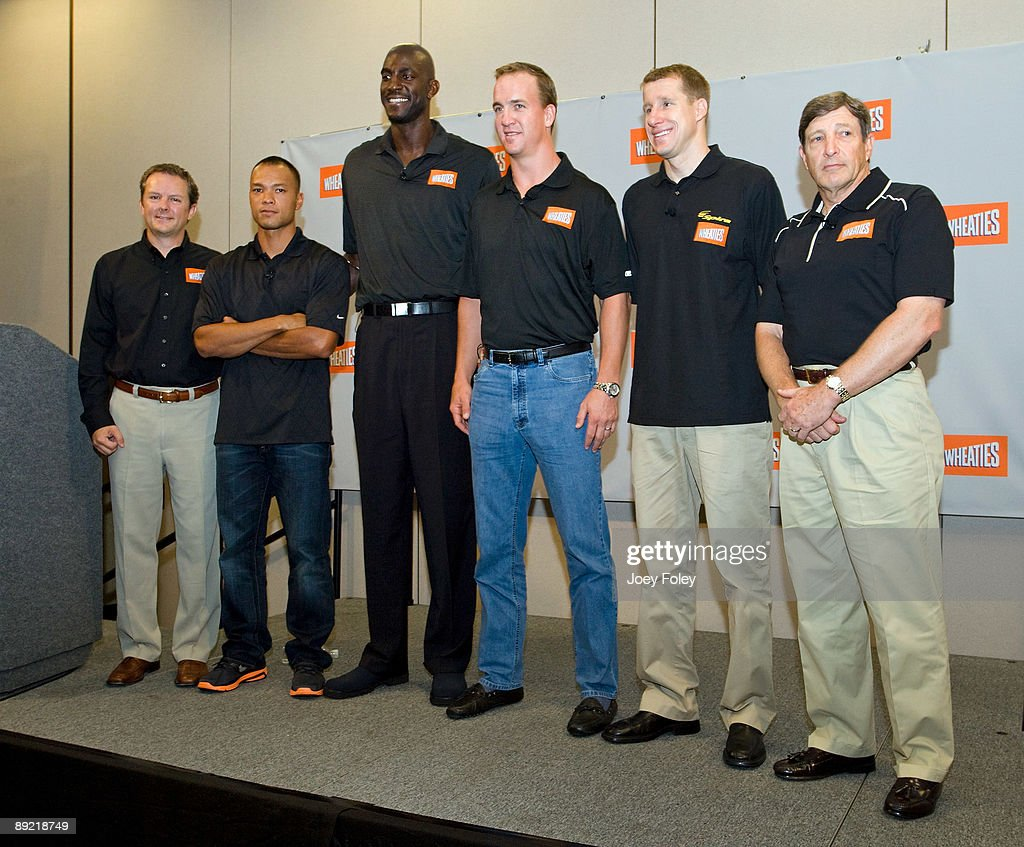 Guest, Gold medal winning decathlete Bryan Clay, NBA star Kevin Garnett, Indianapolis Colts quarterback Peyton Manning, triathlete Hunter Kemper and sports nutritionist Dr. John Ivy pose for a photo during a press conference at Conseco Fieldhouse on July 23, 2009 in Indianapolis, Indiana.