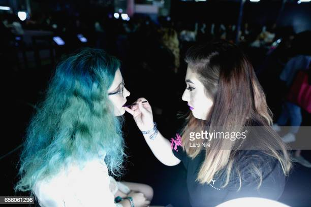 A guest has her makeup done during Beautycon Festival NYC 2017 at Brooklyn Cruise Terminal on May 20 2017 in New York City