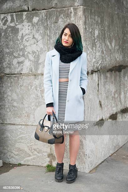 Guest Heloise Correia wears a Forever 21 coat New Look handbag skirt and top by Monkie and shoes by Aldo on day 3 of Paris Haute Couture Fashion Week...