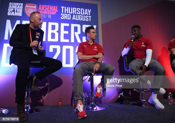 Guest host Andrew Mangan with Laurent Koscielny and Danny Welbeck of Arsenal during QA during Memebers Day at Emirates Stadium on August 3 2017 in...