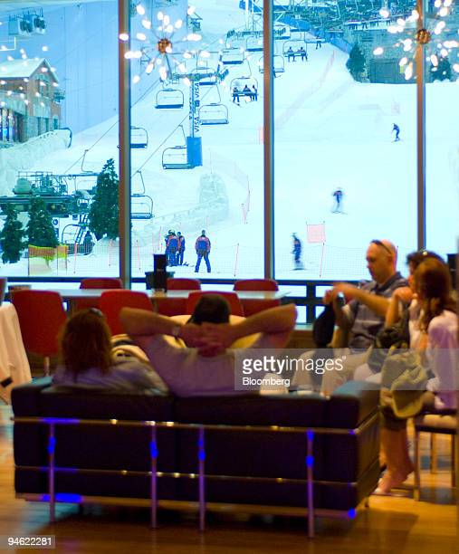 Guest in 'Apres' a cocktail lounge bar and restaurant watch skiers at Ski Dubai at the Mall of the Emirates in Dubai United Arab Emirates Sunday...