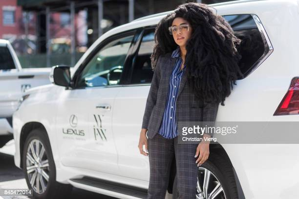 A guest in front of a Lexus seen in the streets of Manhattan outside Tome during New York Fashion Week on September 10 2017 in New York City