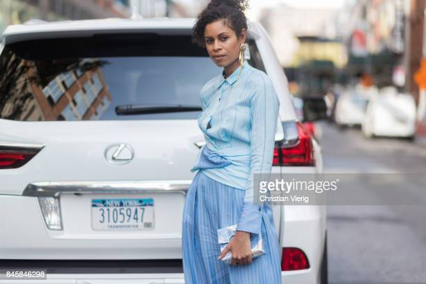 A guest in front of a Lexus seen in the streets of Manhattan outside Phillip Lim during New York Fashion Week on September 11 2017 in New York City