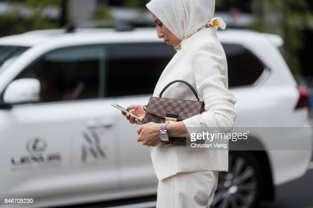 A guest in front of a Lexus seen in the streets of Manhattan outside Marchesa during New York Fashion Week on September 13 2017 in New York City