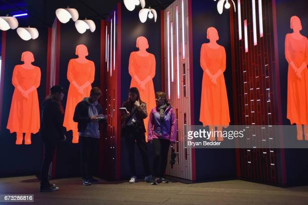 Guest interact with an art installation designed by Paula Scher and Abbott Miller and book giveaway celebrating Hulu's 'The Handmaid's Tale' opens on...