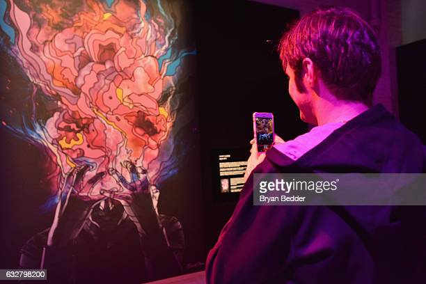 A guest interacting with the artwork at the FX's Legion WhereHouse at Villian on January 26 2017 in Brooklyn New York