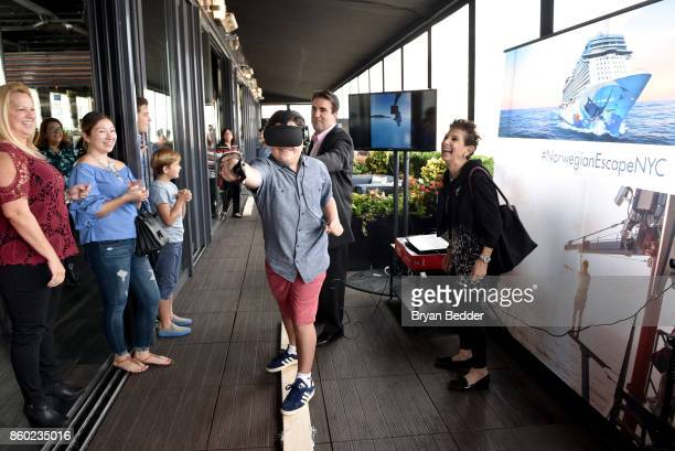 A guest interacts with a VR experience during Norwegian Escape heads to NYC event with Godfather Pitbull at PHD at the Dream Downtown on October 11...