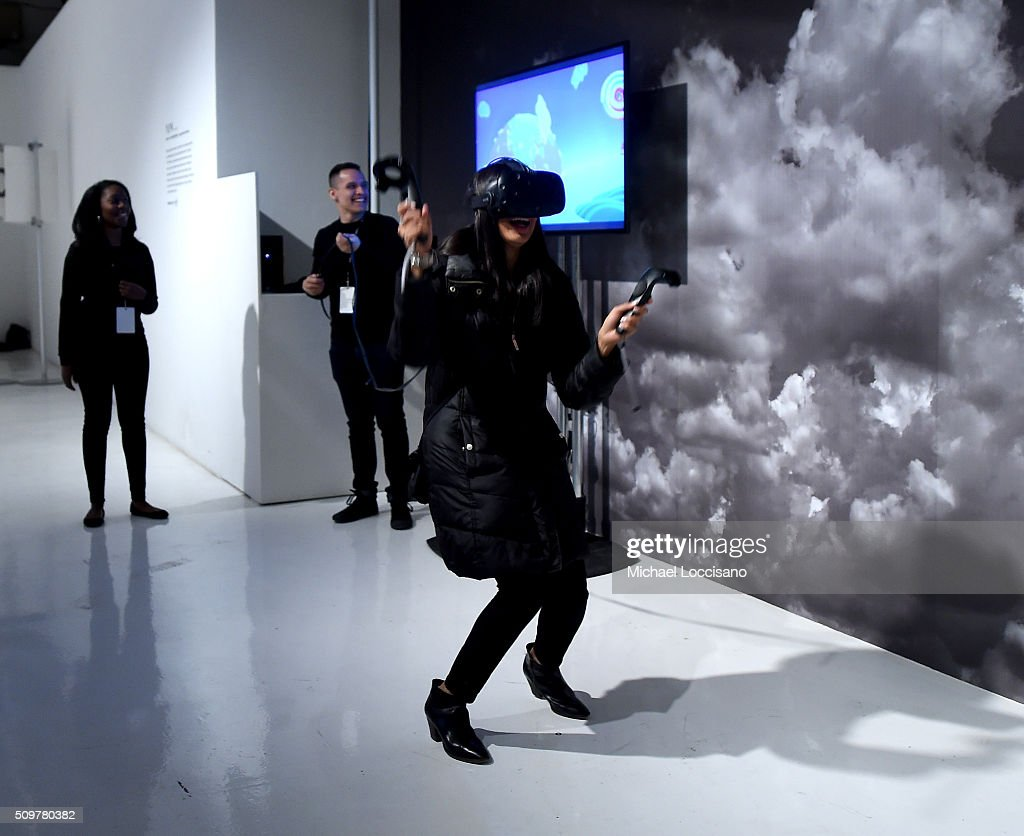 A guest interacts with displays during New York Fashion Week: The Shows at Clarkson Sq on February 12, 2016 in New York City.