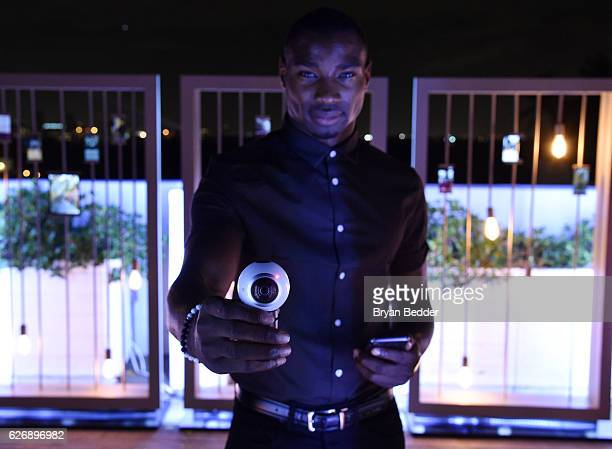 A guest interacts with the Samsung 360 camera during Prabal GurungÕs Samsung Gear 360 Exhibition at Ocho at Soho Beach House during Art Basel on...