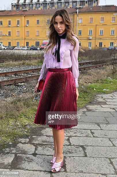 A guest is pictured in the street before a show as part of the Autumn / Winter 2016 Milan Fashion Week on February 24 2016 AFP PHOTO / GABRIEL BOUYS...