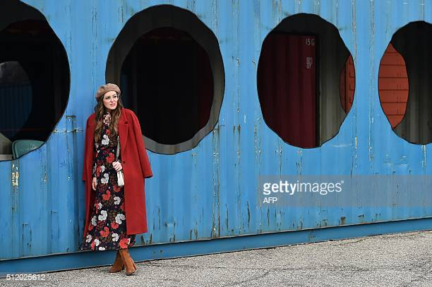 TOPSHOT A guest is pictured in the street before a show as part of the Autumn / Winter 2016 Milan Fashion Week on February 24 2016 AFP PHOTO /...