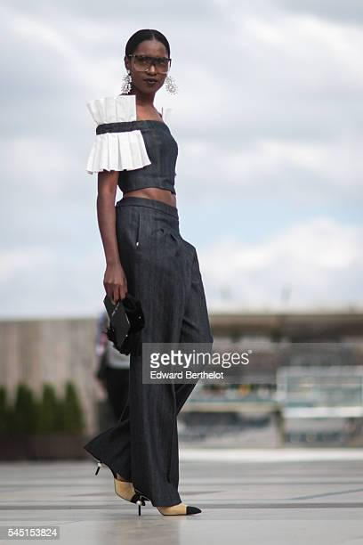 A guest is seen after the Armani show during Paris Fashion Week Haute Couture F/W 2016/2017 on July 5 2016 in Paris France