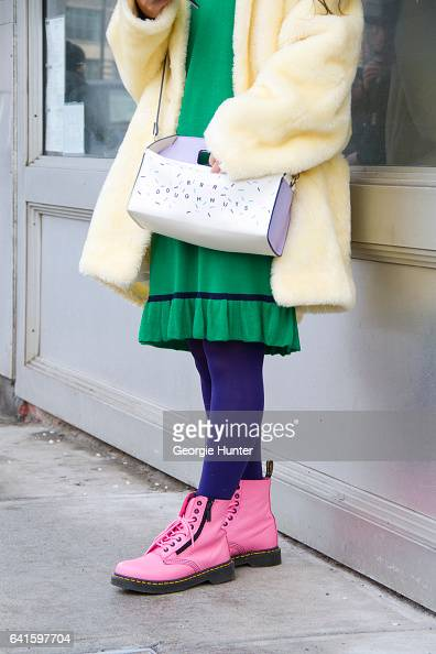 Guest is seen at Spring Studios outside the Lacoste show wearing 1920's style green dress lemon yellow faux fur coat pink Dr Martens lace up boots...