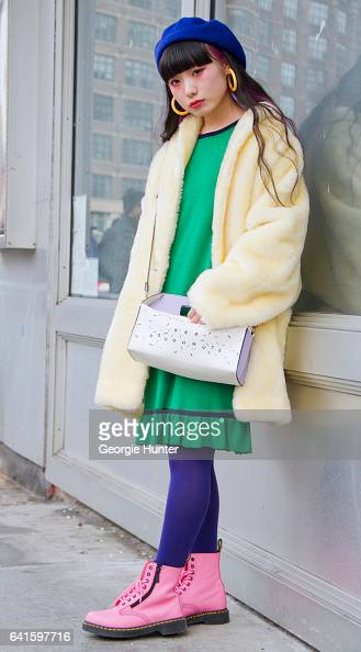 Guest is seen at Spring Studios outside the Lacoste show wearing 1920's style green dress lemon yellow faux fur coat blue beret hat plastic yellow...