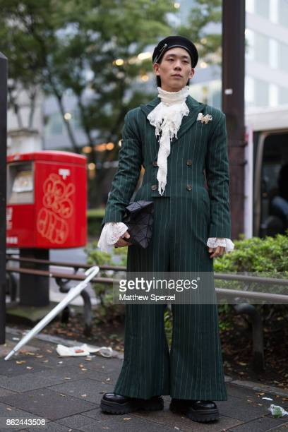 A guest is seen attending AKIKOAOKI during Tokyo Fashion Week wearing a green pants suit with black beret on October 17 2017 in Tokyo Japan
