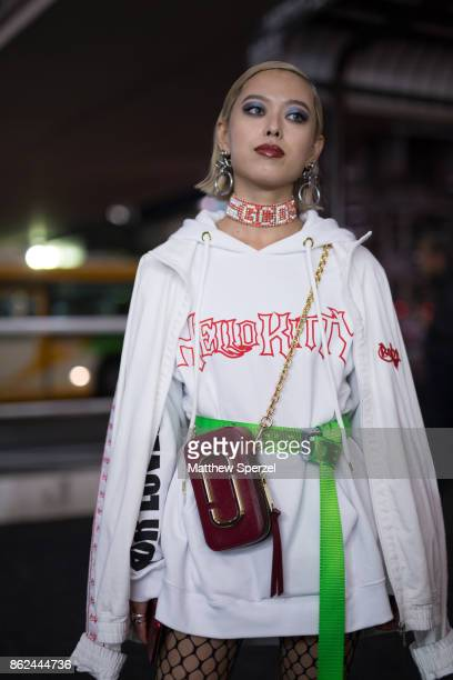 A guest is seen attending Fashion Hong Kong during Tokyo Fashion Week wearing a white outfit with neon green belt choker and fishnets on October 17...