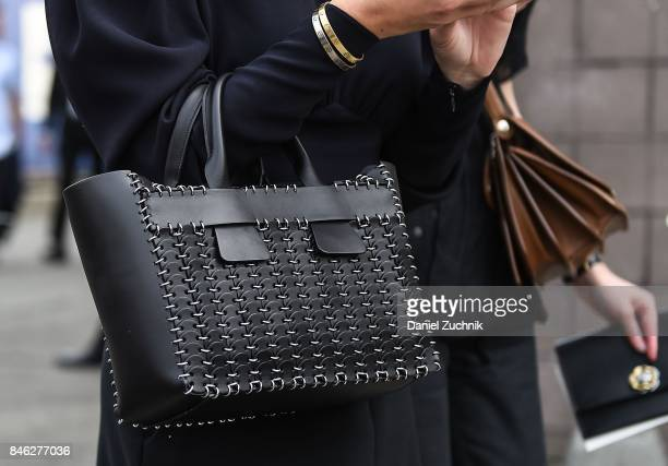 A guest is seen black bag outside the Coach show during New York Fashion Week Women's S/S 2018 on September 12 2017 in New York City