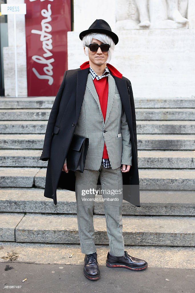 Guest is seen during Milan Fashion Week Menswear Autumn/Winter 2014 on January 12, 2014 in Milan, Italy.