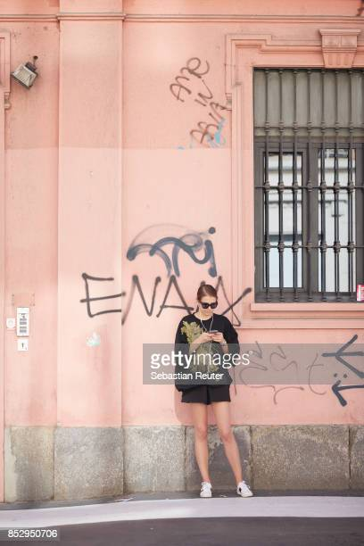 A guest is seen during Milan Fashion Week Spring/Summer 2018 on September 24 2017 in Milan Italy