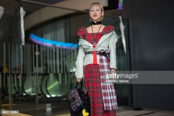 A guest is seen on the street attending Tokyo Fashion Week on October 19 2017 in Tokyo Japan