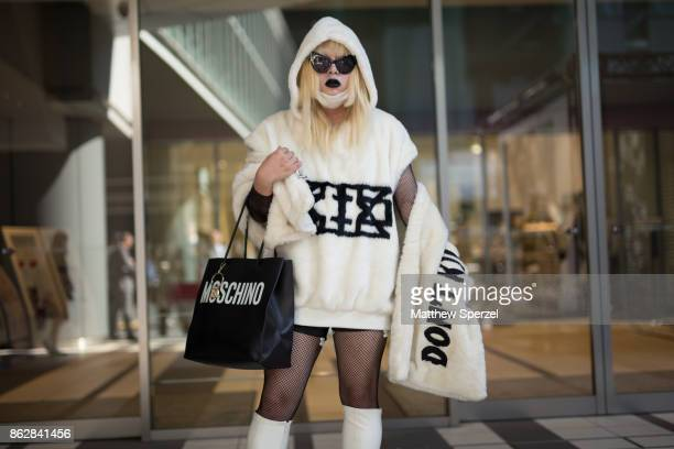 A guest is seen on the street attending Tokyo Fashion Week wearing a cream outfit on October 18 2017 in Tokyo Japan