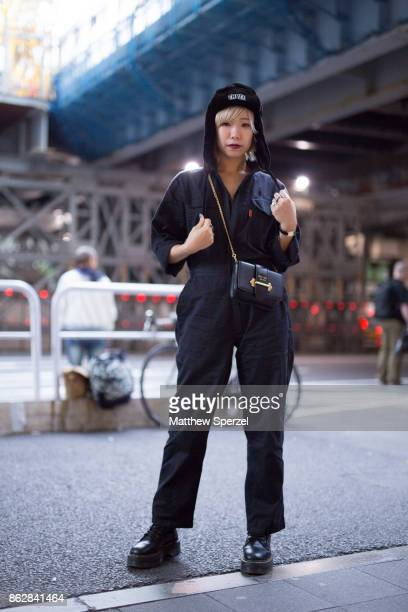 A guest is seen on the street attending Tokyo Fashion Week wearing a navy jumpsuit on October 18 2017 in Tokyo Japan