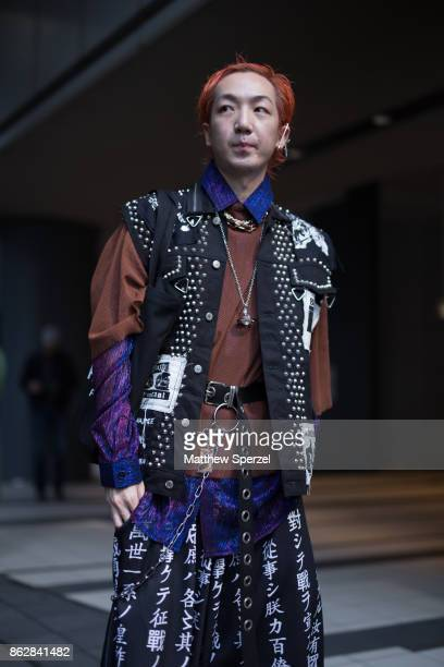 A guest is seen on the street attending Tokyo Fashion Week wearing a black punk vest on October 18 2017 in Tokyo Japan