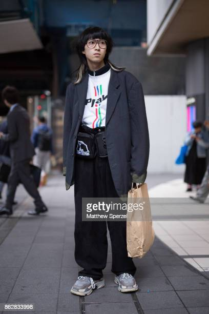 A guest is seen on the street attending Tokyo Fashion Week wearing an oversized blazer with utility belt on October 18 2017 in Tokyo Japan