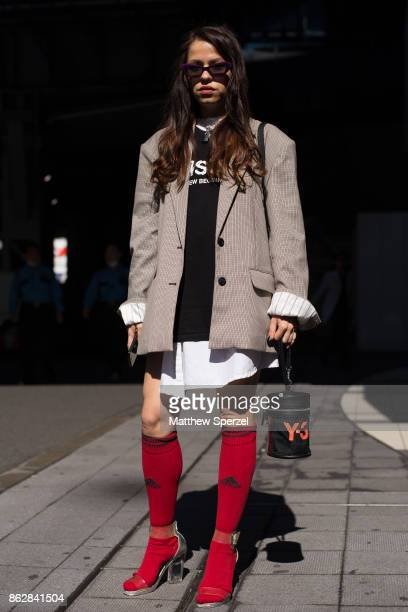 A guest is seen on the street attending Tokyo Fashion Week wearing Y3 and Adidas on October 18 2017 in Tokyo Japan