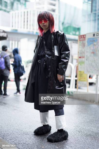 A guest is seen on the street during Tokyo Fashion Week wearing an all black outfit with black fur shoes on October 21 2017 in Tokyo Japan