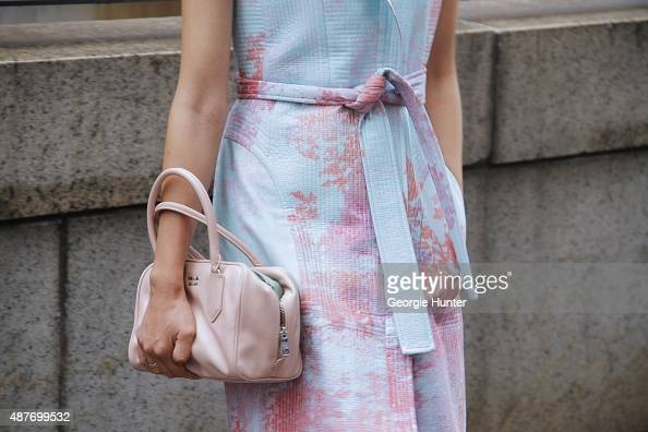 Guest is seen on the streets of Manhattan outside of the Erin Fetherston Spring Summer 2016 fashion show at Skylight at Moynihan Station wearing...