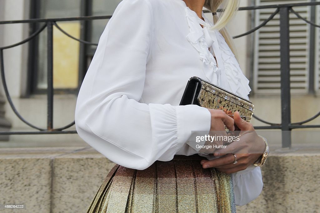 Guest is seen on the streets of Manhattan outside of the Jeremy Scott Spring 2016 fashion show at Skylight at Moynihan Station wearing white shirt...