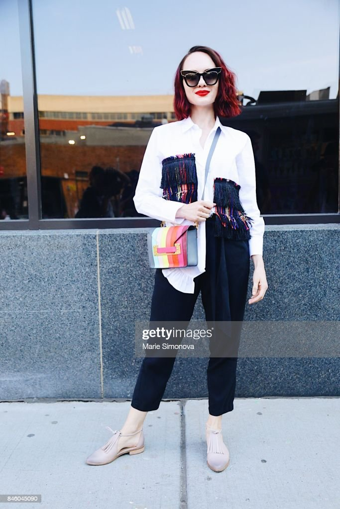 A guest is seen outside Skylight Clarkson wearing printed shirt and bag during New York Fashion Week on September 11, 2017 in New York City.