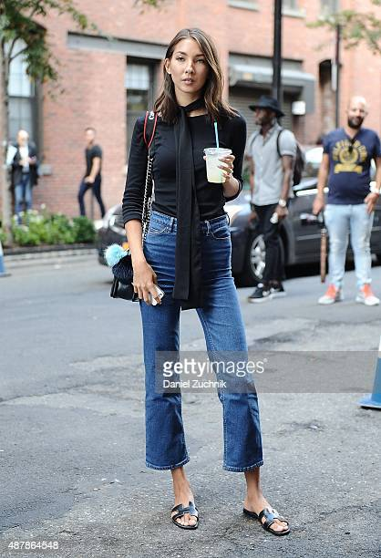 A guest is seen outside the Cushnie et Ochs show wearing a Zara top HM jeans Hermes shoes and Chanel bag during New York Fashion Week 2016 on...