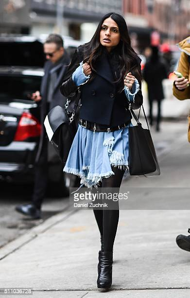 A guest is seen outside the DKNY show wearing a blue ripped dress during New York Fashion Week Women's Fall/Winter 2016 on February 17 2016 in New...