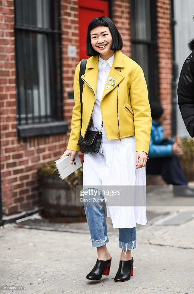 A guest is seen outside the DKNY show wearing a yellow leather jacket during New York Fashion Week Women's Fall/Winter 2016 on February 17 2016 in...