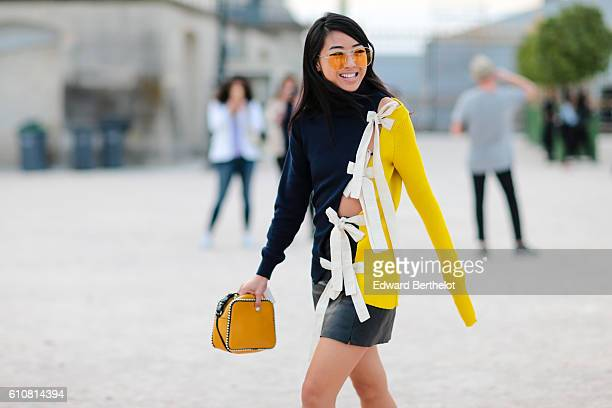 A guest is seen outside the Jacquemus show at the Tuileries Garden during Paris Fashion Week Spring Summer 2017 on September 27 2016 in Paris France