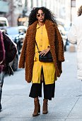 A guest is seen outside the Jonathan Simkhai show wearing a brown coat and mustard yellow blouse during New York Fashion Week Women's Fall/Winter...