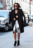 A guest is seen outside the Jonathan Simkhai show wearing a choker black coat and silver shiny skirt during New York Fashion Week Women's Fall/Winter...