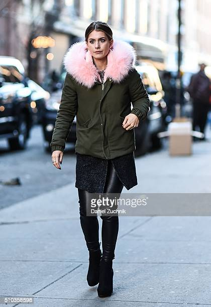 A guest is seen outside the Jonathan Simkhai show wearing a green coat with a pink fur collar during New York Fashion Week Women's Fall/Winter 2016...
