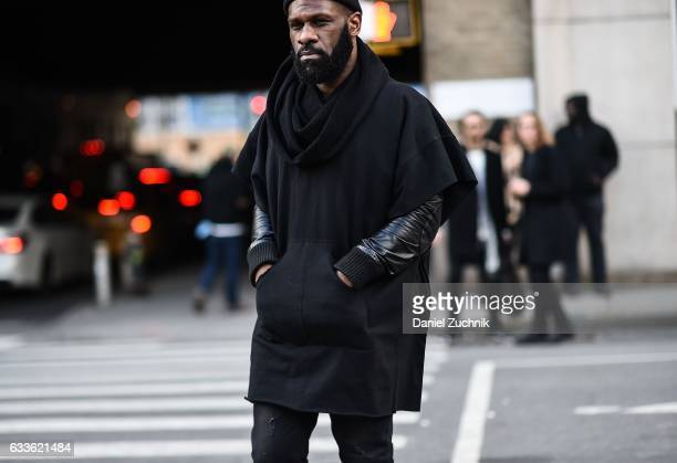 A guest is seen wearing a black sweatshirt outside of the STAMPD show during New York Fashion Week Men's AW17 on February 2 2017 in New York City