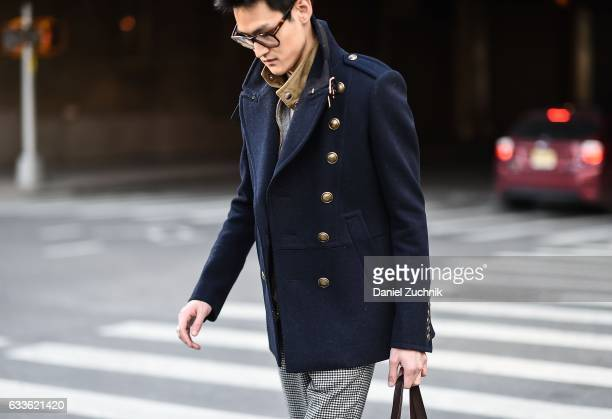 A guest is seen wearing a blue military jacket outside of the STAMPD show during New York Fashion Week Men's AW17 on February 2 2017 in New York City