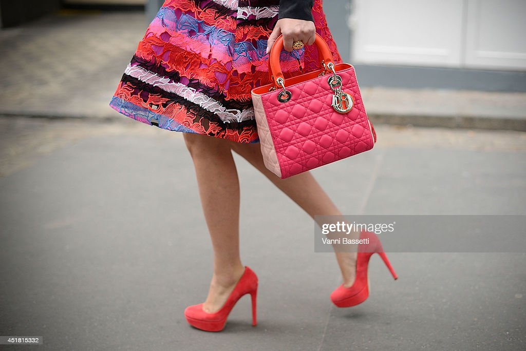 A guest is seen wearing a Dior bag before Dior show on July 7, 2014 in Paris, France.